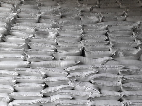 Chemical fertilizer The product stock is packed in sacks, stacked in the warehouse, waiting for delivery.