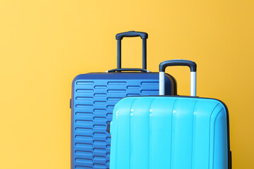 Packed suitcases on color background. Travel concept Fotobehang