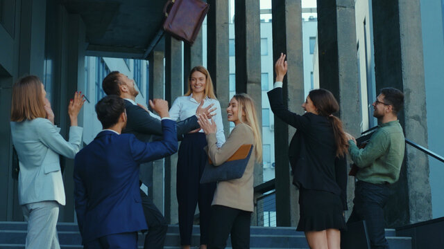 Female boss businesswoman motivating her employees outside office building, coaching for teambuilding successful collaboration start-up. Business concept.
