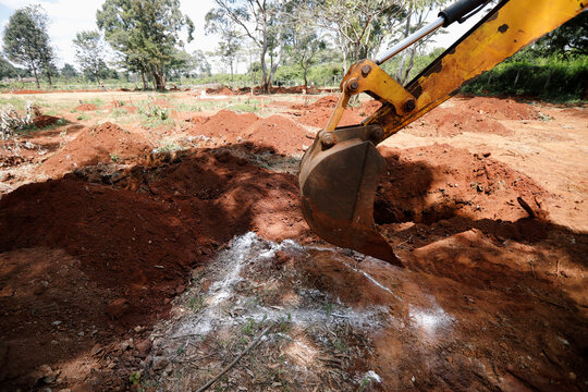 An excavator is seen digging a new grave at the separated section of the muslim cemetery, amid the coronavirus disease (COVID-19) outbreak, in Nairobi