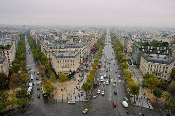 Aerial view of two streets of Paris with cars driving on the roads