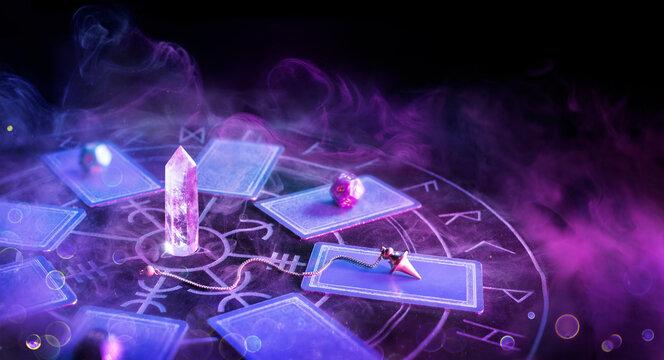 Cartomancy - Pendulum On Blurred Altar With Defocused-Tarot Cards And Smoke