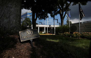 """A """"No trespassing"""" sign in pictured near the National Rifle Association (NRA) headquarters, in Fairfax"""