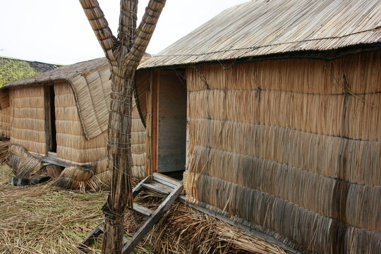 Two huts of reeds made by the indigenous people of lake Titicaca in Peru, South America