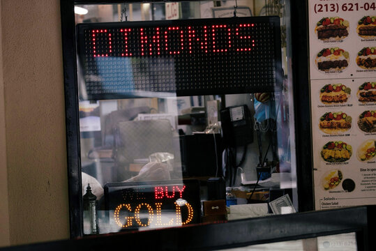 A store advertises buying gold in the downtown jewellery district in Los Angeles