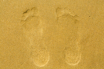 foot prints of human feet on the sand. vacation concept