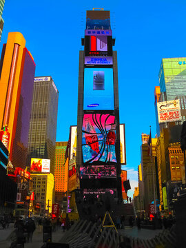 New York, USA - February 13, 2013: The Times Square is a busy tourist intersection of neon art and commerce and is an iconic street of New York City and America