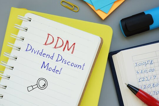 Dividend Discount Model DDM inscription on the piece of paper.