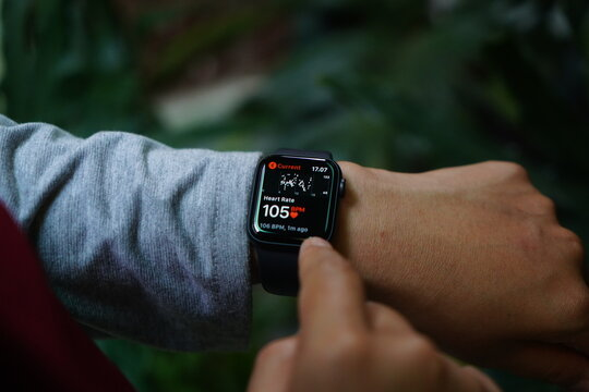 Bali Indonesia August 29, 2020: Close up hand monitoring Heart Rate on a smartwatch