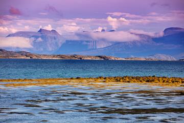 Fototapete - Fjord at sunset. Rocky seashore in the evening.  Beautiful nature of Norway. Picturesque Scandinavian landscape. Lofoten islands, Norway, Europe