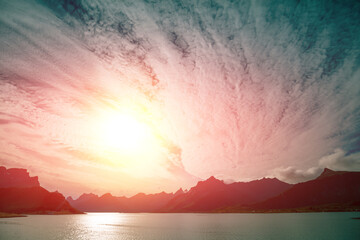 Fototapete - Fjord at sunset with dramatic sky. Rocky seashore in the evening.  Beautiful nature of Norway. Picturesque Scandinavian landscape. Lofoten islands, Norway, Europe