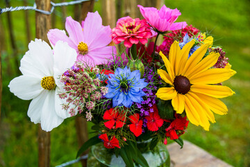 bouquet of colorful wild flowers with sunflowers and cosmos flowers - summer background and...