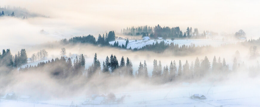 Winter landscape with mist on mountain hills panoramic view, banner