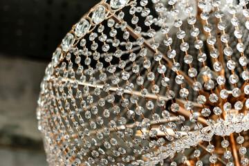 Chrystal chandelier close-up in loft interior