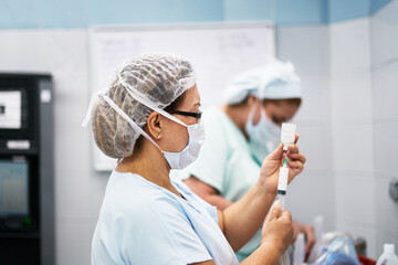 Nurse getting medicine ready for a patient