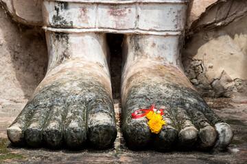Foto op Aluminium Historisch mon. Detail of feet of a Buddha statue, Sukhothai Historical Park, Thailand.