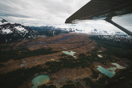 Looking Out of a Plane at Glacial Lakes In Alaska