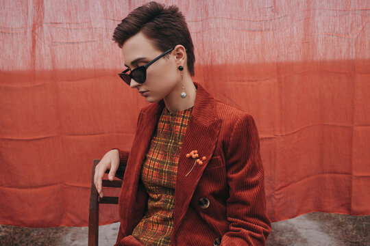 Trendy woman in vintage sunglasses and jacket