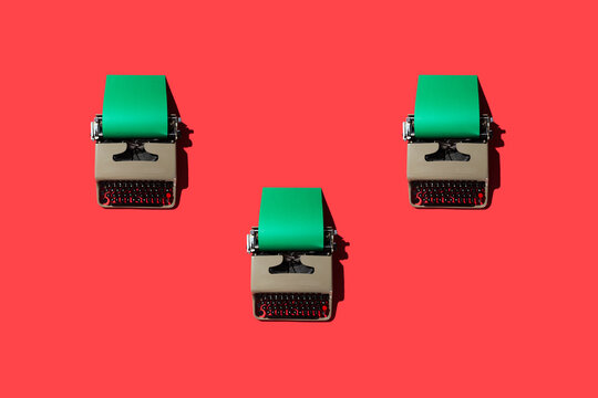 Typewriters on Red Backdrop