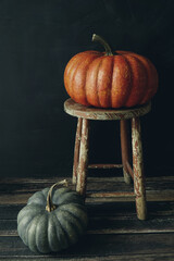 Colored pumpkins on wooden stool