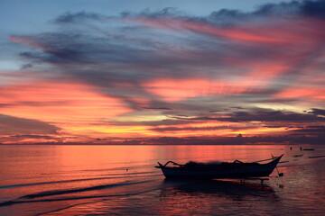 Fishing boat silhouette at dusk. White beach. Aklan. Western Visayas. Philippines