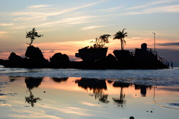 Willy rock silhouette at dusk. White beach. Aklan. Western Visayas. Philippines