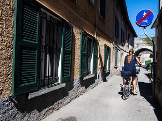 Cycling scene in an old italian alley