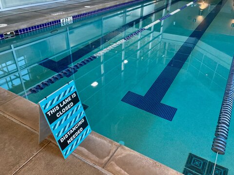 swimming pool with social distancing sign