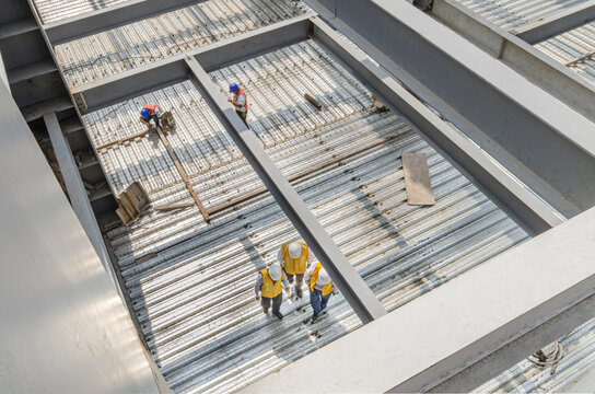 High angle view of metal girders and flooring made with steel plates Engineers supervising the correct progress of construction site