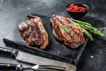 Printed kitchen splashbacks Steakhouse Grilled top sirloin cap or picanha steak on a stone chopping Board. Black background. Top view