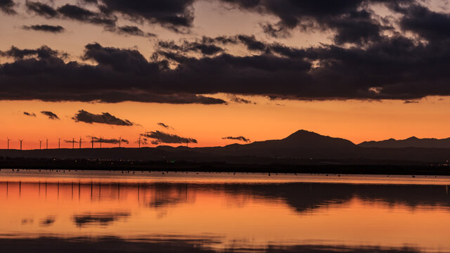 Beautiful mountain range landscape near a lake in a small village in Cyprus during sunset