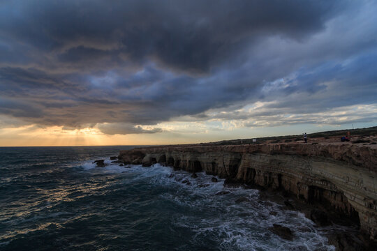 Stormy Weather sunset at sea Caves in Cape Grego Ayia Napa, Cyprus