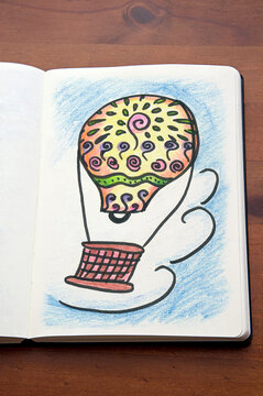 hot air balloon_colored pencil_drawn_paper notebook_upright