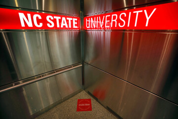 A sign on the floor instructs occupants where to stand in one of the elevators in the Talley Student Union, at the campus of North Carolina State University, in Raleigh