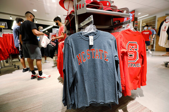 Students shop for college shirts and other merchandise at the campus of North Carolina State University in Raleigh