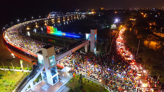 Aerial view of nighttime fountain attraction at Surabaya bridge, East Java, Indonesia which attracts local tourists