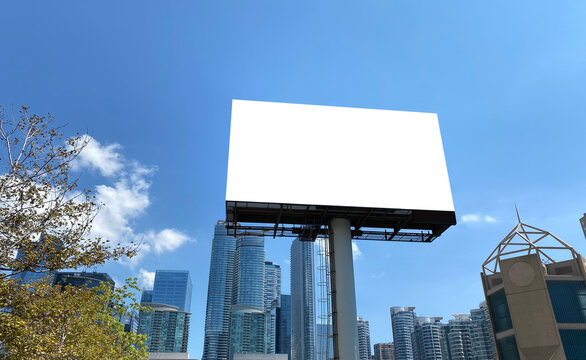 Blank billboard with downtown background to be used for advertising simulations, templates or mockups.