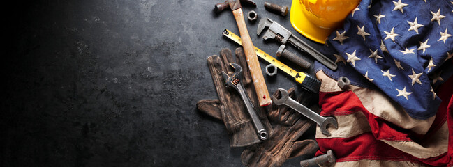 Construction and manufacturing tools with patriotic US, USA, American flag on dark black background
