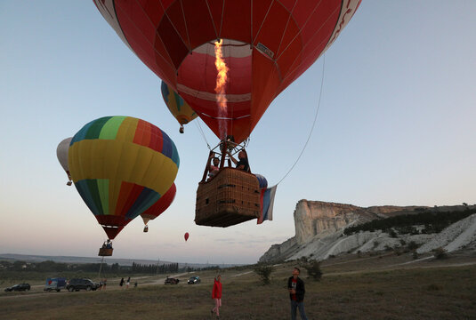 Aeronaut teams take part in a hot air balloon competition in Crimea