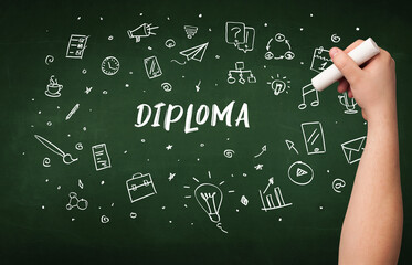 Hand drawing DIPLOMA inscription with white chalk on blackboard, education concept