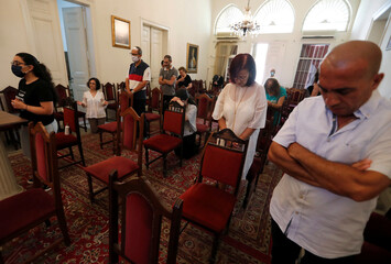 Christians attend a church Sunday service following Tuesday's blast in Beirut