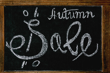 Autumn sale concept. Vintage chalkboard with hand written lettering Sale with percents.
