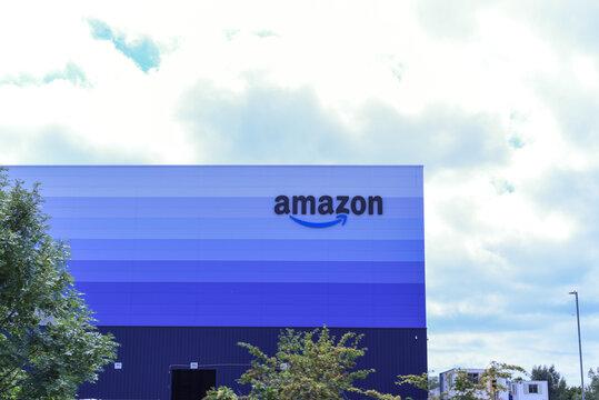 August 9, 2020 Milton Keynes/ UK - Amazon Prime logo on exterior of distribution centre building