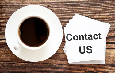 Word writing text CONTACT US . Business concept for Urgent Move.Text in stickers with a cap of coffee