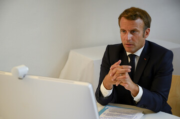 French President Emmanuel Macron attends a donor teleconference with other world leaders, in Bormes-les-Mimosas