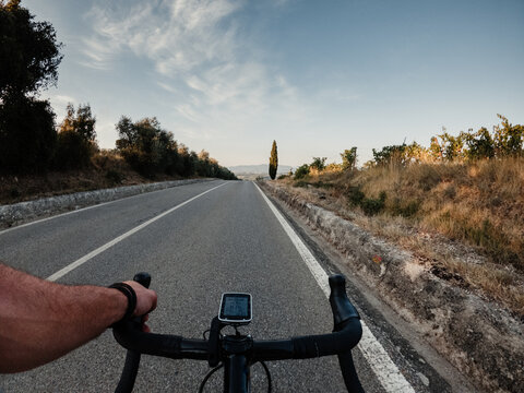 Riding a road bicycle in Tuscany on summer
