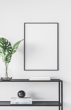 Design modern interior of living room with black metal console, green leaves in vase, mock up poster frame and elegant accessories. Stylish home interior.  trendy home decor.