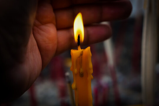 Light a candle to worship is the belief of Buddhism.