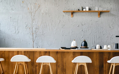 Seat and wooden counter with coffee equipment and wooden shelf on rough cement wall. design for cafe or home