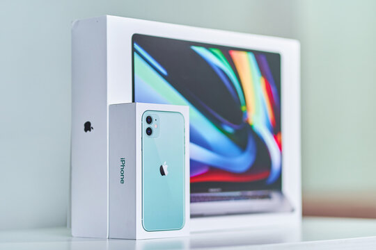 Batumi, Georgia. 27 July 2020 - Boxes of mint green iPhone 11 with dual camera and 16 inch MacBook Pro of 2019 release. Apple gadgets